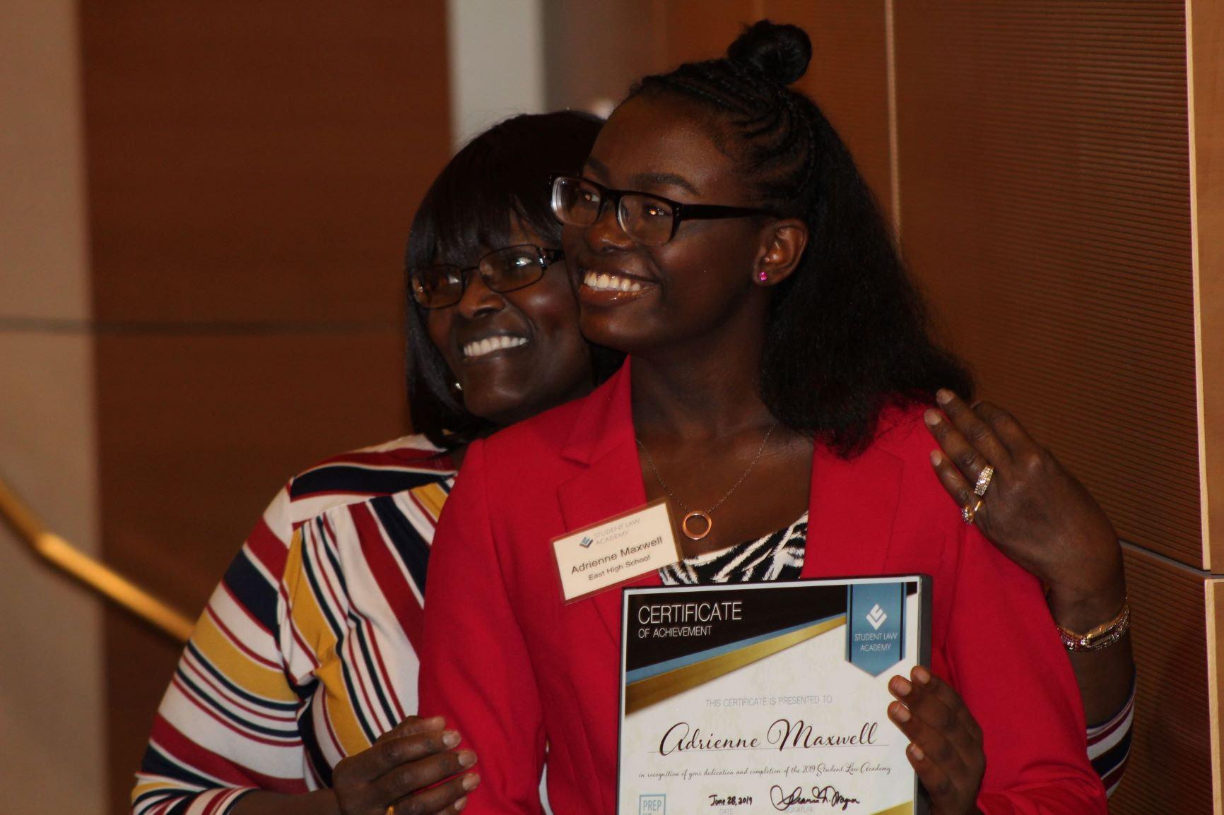 Student Law Academy graduate with her mother